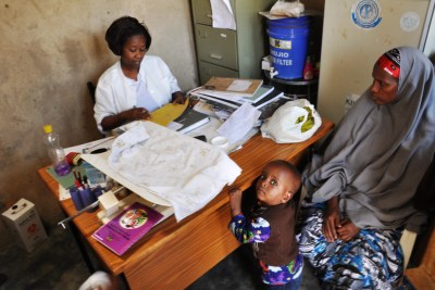 A mother consults a nurse: Uganda considered the most corrupt in healthcare in East Africa region.