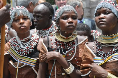 Young women perform in traditional dress in Arusha, Tanzania.