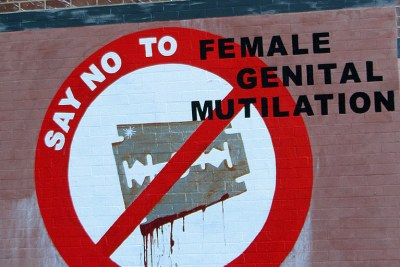 Graffiti opposing female genital mutilation or cutting.