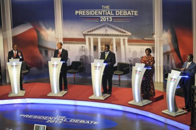 Presidential candidates during the final debate before elections on March 4, 2013 (file photo).