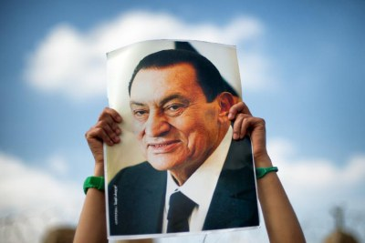 A supporter holds a poster of Egyptian former President Hosni Mubarak (file photo).