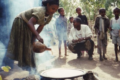 A Falasha villager in Wolleka shows how injera, using a teff flour batter, is made.
