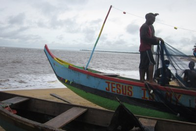 Picturesque fishing canoes do the serious work of supplying some 80 percent of protein for large areas of Liberia. This boat in Banjor Beach, Monrovia can extend its productive hours using solar powered lights.