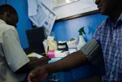 A HIV positive homosexual man has his blood pressure checked at a VCT clinic supported by the Global Fund via the Kenyan Red Cross.