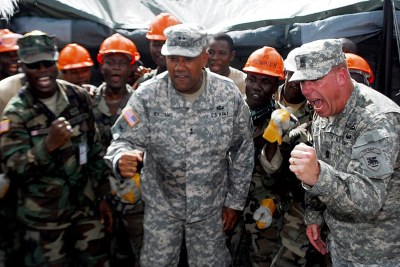 U.S. troops collaborated with Armed Forces of Liberia engineers to build Ebola treatment centers.