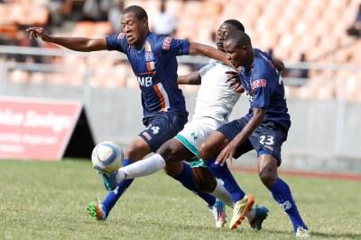 Ammy Ali and Mkami Himid Maoof Azam FC tackles Erick Ochieng of Gor Mahia FC (file photo).