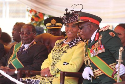 President Robert Mugabe looks on as First Lady Grace Mugabe talks to Commander of the Zimbabwe Defence Forces Constantine Chiwenga (file photo).