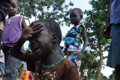 hildren look on questioningly as their colleague cries. The children are part of the many refugees at the Pagirinya Refugee settlement in Adjumani, near Uganda's border with South Sudan (file photo).