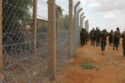 Kenya Defence Forces personnel inspect the ongoing fencing of the Kenya-Somalia border in Mandera County