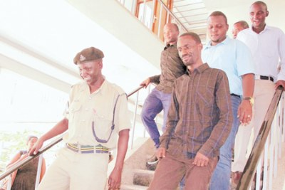 The founder of JamiiForums Maxence Melo escorted by police returning to remand.