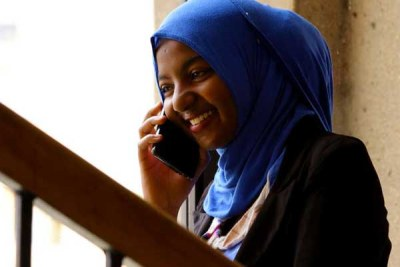 A woman using a mobile phone. Safaricom subscribers were unable to make calls after the company experienced a technical hitch on April 24, 2017.