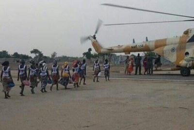 Chibok schoolgirls get on helicopter..