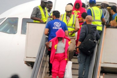 Immigration officials screening Nigerian returnees from Libya during their arrival at the Murtala Muhammed International Airport in Lagos.