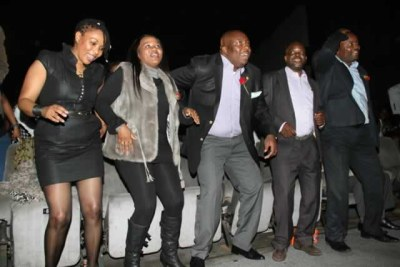 Zanu-PF national political commissar Saviour Kasukuwere (third from left) and some revelers (file photo).