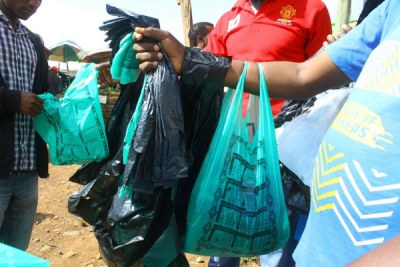 Plastic bag vendors at Kisii fresh produce market.