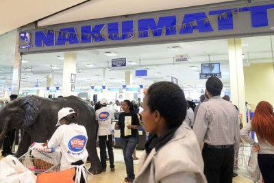 Shoppers enter Nakumatt supermarket in Garden City Mall in Nairobi.