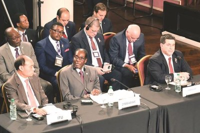 President Mugabe addresses a plenary session of the World Health Organisation Global Conference on Non-Communicable Diseases in Montevideo, Uruguay.
