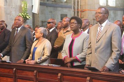 From left: President Uhuru Kenyatta and Chief Justice David Maraga, accompanied by their wives, attend a service at All Saints Cathedral, Nairobi (file photo).