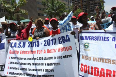 Members of the Universities Staff Academic Union protest at Harambee Avenue.