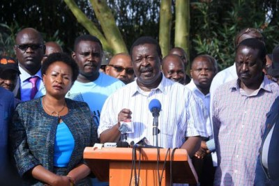 Nasa co-principal Musalia Mudavadi flanked by Raila Odinga and other coalition leaders address the media on November 25, 2017.