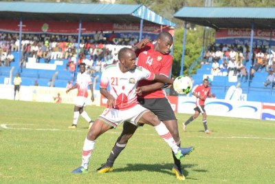 Harambee Stars' Whyvonne Isuza (left) fights for the ball with Libya's Madeen Muhanad during the Cecafa Senior Challenge Cup match at Kenyatta Stadium in Machakos County on December 5, 2017.