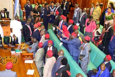 MPs opposed to the lifting of the presidential age limit stand in protest during a plenary session in September.