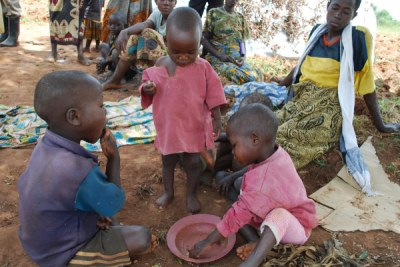 Children share food at Nakivale Refugee Camp in the Isingiro district (file photo).