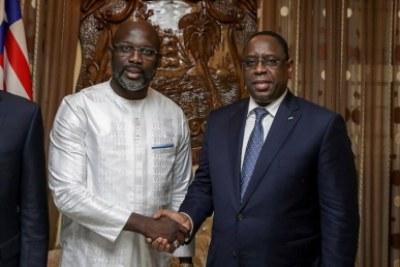Le président libérien Georges Weah en compagnie de son homologue sénégalais Macky Sall.