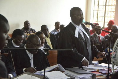Government lawyers led by the deputy Attorney General Mwesigwa Rukutana consult during the age limit petition in Mbale.