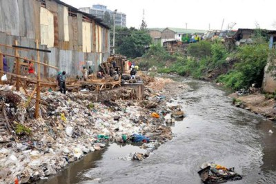 A section of the garbage-filled Nairobi River flows next to Machakos Country Bus Station.