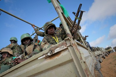 Ugandan soldiers serving with the African Union Mission in Somalia (AMISOM) prepare to deploy near the Somali capital of Mogadishu in an area that became home to a large refugee population (file photo).