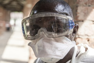 An Ebola health worker at Bikoro Hospital, Democratic Republic of the Congo.