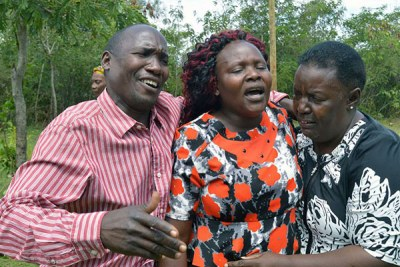 The mother of slain Sharon Otieno, Melida Auma (centre), is comforted by her relatives at their home in Magare village, Homa Bay County (file photo).