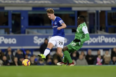 Everton's Kieran Dowell makes a pass under pressure from Gor Mahia's Philemon Otieno during their SportPesa Trophy match at Goodison Park on November 6, 2018