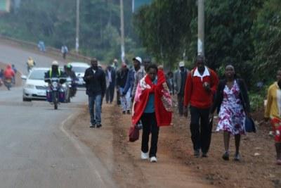 Kenyans in Nyeri County walk to their destinations.