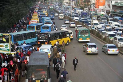 Matatus pick up passengers along Murang'a Road in nairobi on December 3, 2018 when a ban prohibiting them from accessing the CBD took effect.
