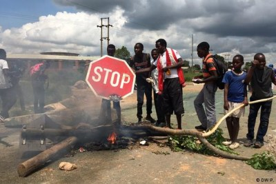 Police were deployed across Harare after protesters blocked a number of roads.