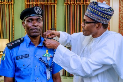 President Buhari decorated the new Inspector-General of Police, Abubakar Adamu Mohammed, at the State House.