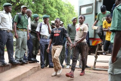 Some of the fuel price increase protestors arrive at the Harare Magistrate's Courts.