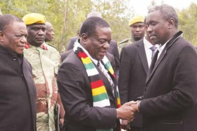 President Emmerson Mnangagwa with Kudakwashe Tagwirei at the burial of the businessman's father, Sekuru Phineas Tagwirei, in May 2018. Vice President Constantino is on the left.