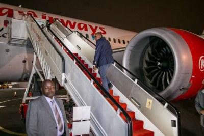 President Uhuru Kenyatta boards a Kenya Airways flight at the Jomo Kenyatta International Airport, Nairobi for a State visit to the United States of America (file photo).