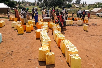 People line up at a borehole at Kiryandongo refugee settlement camp during a water crisis that hit the region in November last year.