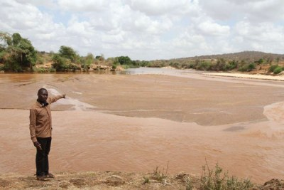 A man points to the site of the proposed Thwake dam at the confluence of Thwake and Athi rivers at the border of Kitui and Makueni counties (file photo).