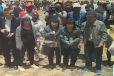 Family members visit the site of the Ethiopian Airlines crash.