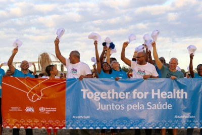World Health Organization Regional Director for Africa, Dr Matshidiso Moeti, and H.E. Dr Fernando Elísio Freire, Minister of State, Parliamentary Affairs, President of the Council of Ministers and Minister of Sports joined hundreds of people who held hands and stood side by side in an umbrella shape on Quebra Canela beach in Praia to show their solidarity for universal health coverage.