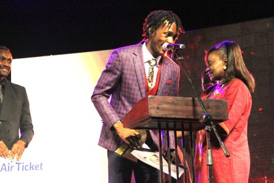 Enzo Ishall speaks after recieving his award