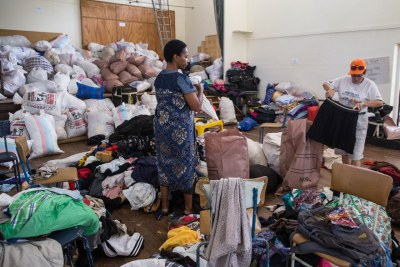 Volunteers pack bags of relief aid at the Presbyterian church in Mutare after Cyclone Idai washed away villages and settlements in the Chimanimani area in eastern Zimbabwe, 18 April.