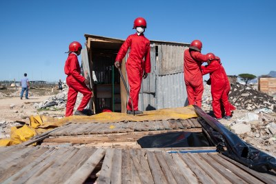 Red Ants demolish a shack occupying private land in Dunoon on Thursday.