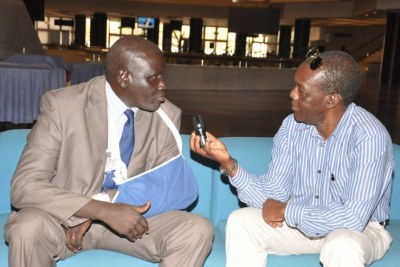 Aggrey Idris (arm in sling), interviewed by VOA's John Tanza Addis Ababa in 2015.