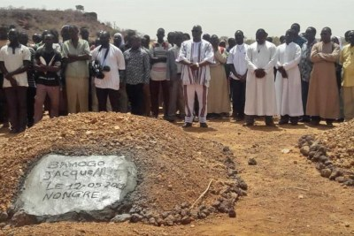 Burial of a priest killed in previous attacks.